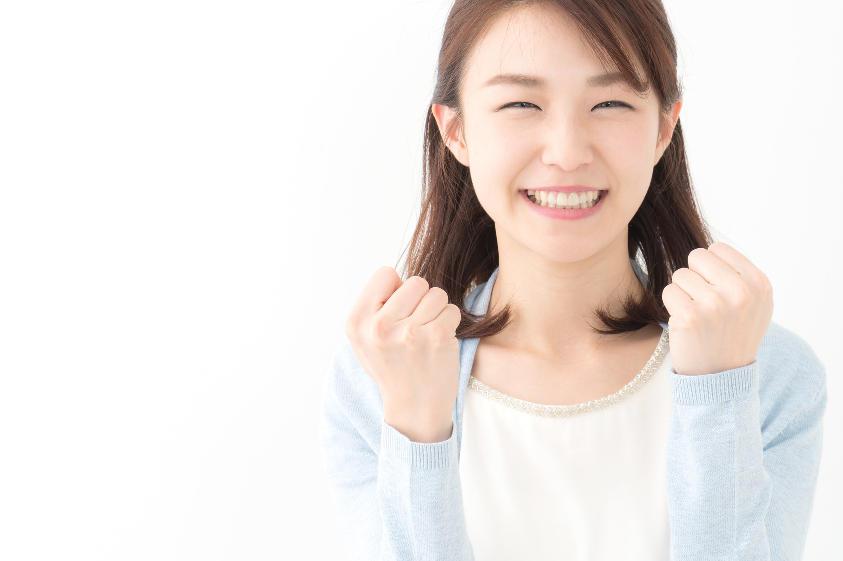 ガッツポーズ・若い女性